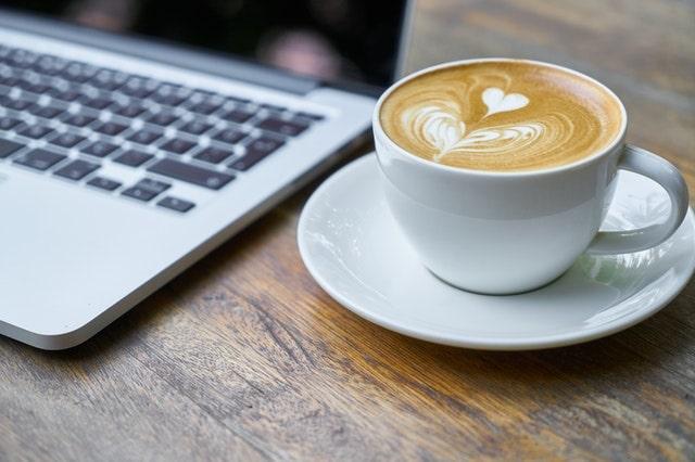 Coffee beside laptop