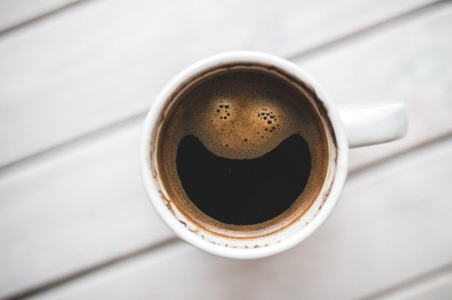 full dark coffee in a cup